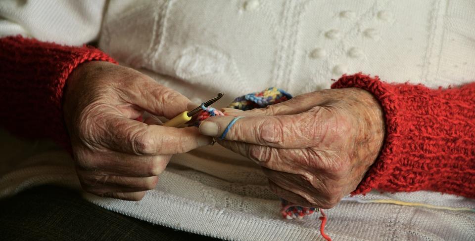 Senior woman doing crochet