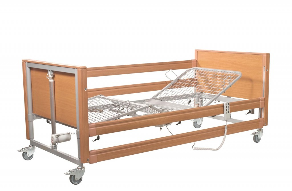 Bed with side rail and mattress lifter