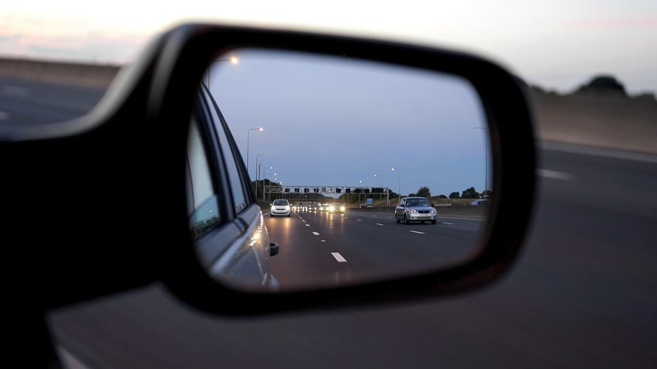Car wing-mirror with night time reflection