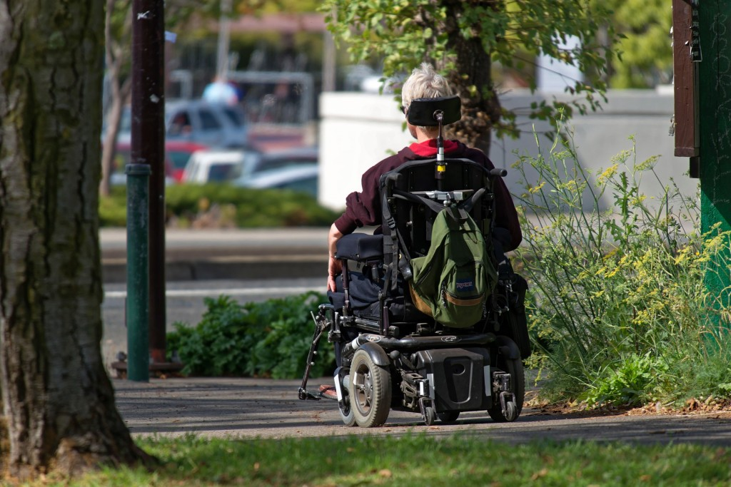 a person using a mobility scooter in a park
